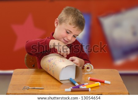 Child Wrapping a Homemade Gift