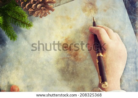 child writes the letter  - stock photo
