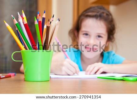 Child writing - stock photo