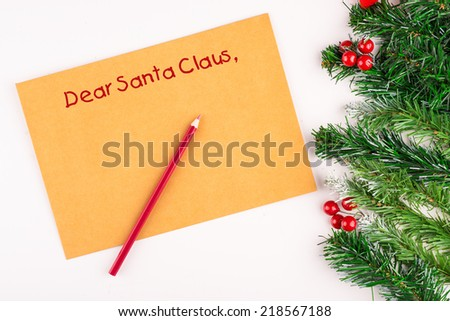 Child writing letter to Santa Claus. Close-up of Christmas letter - stock photo