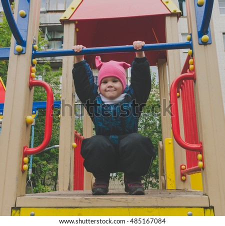 child 4, 5 years old playing in the Playground.
