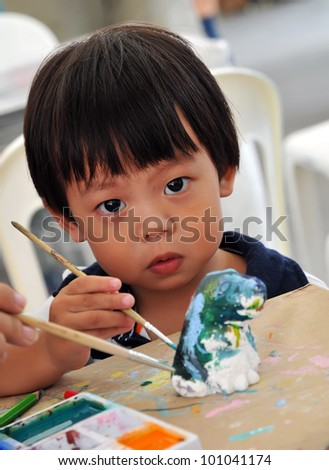 Child 2 years painting in preschool