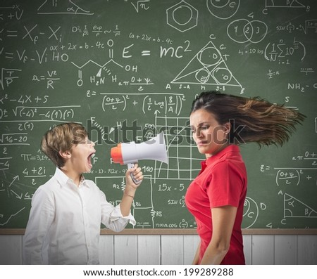 Child yells at her teacher with megaphone - stock photo
