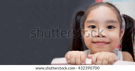 childhood and education concept - happy little girl with chalk drawing Mathematical calculations on blackboard - stock photo