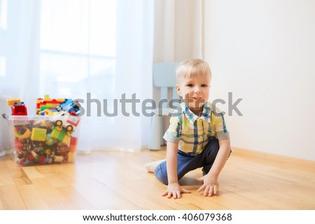 childhood and people concept - happy little baby boy at home