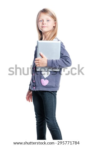 Childhood and technology. Studio portrait of pretty little girl holding tablet computer. Isolated on white. - stock photo