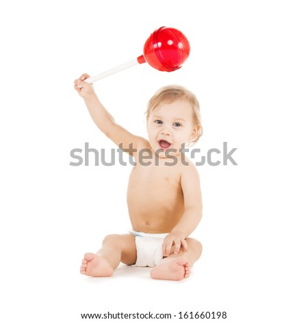 childhood and toys concept - cute little boy playing with big lollipop - stock photo