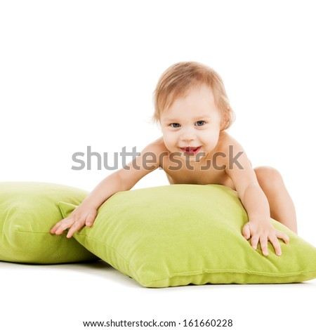 childhood and toys concept - cute little boy playing with green pillows - stock photo