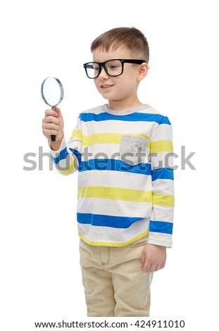 childhood, education, investigation, discovery and people concept - happy little boy in eyeglasses with magnifying glass - stock photo