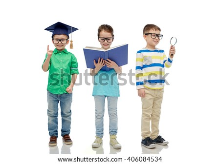 childhood, education, knowledge and people concept - happy little children in eyeglasses with book, magnifying glass and mortar board - stock photo