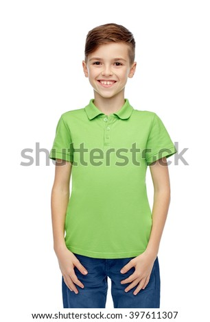 childhood, fashion and people concept - happy smiling boy in green polo t-shirt
