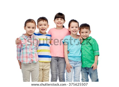 childhood, fashion, friendship and people concept - group of happy smiling little children hugging