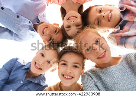 childhood, fashion, friendship and people concept - happy smiling children faces