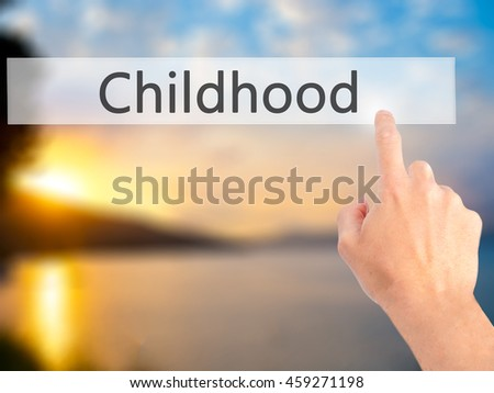 Childhood - Hand pressing a button on blurred background concept . Business, technology, internet concept. Stock Photo
