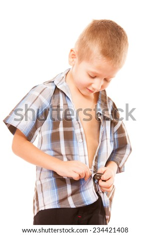 Childhood independence concept ,little boy buttoning on shirt, fastening his buttons , isolated on white background - stock photo