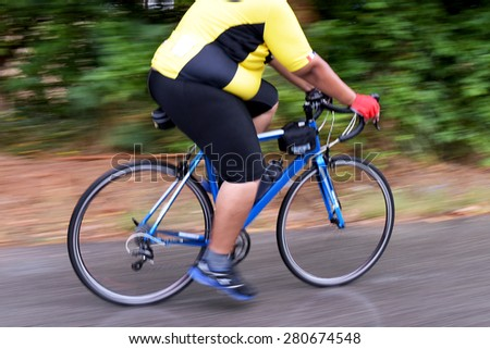 Childhood Obesity Racing Bike motion blur male cycling bicycle.