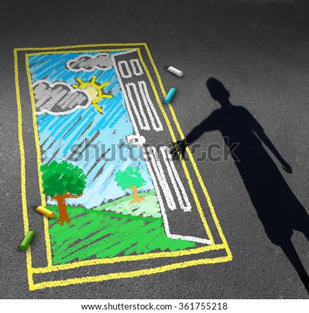 Childhood opportunity concept and child imagination symbol as a shadow of a boy on a pavement with a chalk drawing of an open door with a landscape as a discovery metaphor for learning success. - stock photo