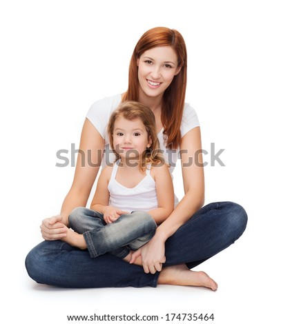 childhood, parenting and relationship concept - happy mother with adorable little girl - stock photo