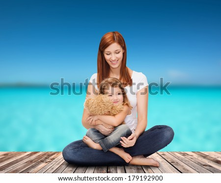 childhood, parenting and relationship concept - happy mother with adorable little girl and teddy bear - stock photo