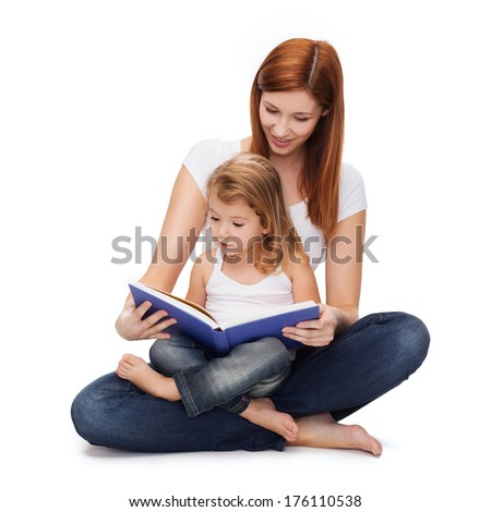 childhood, parenting and relationship concept - happy mother with adorable little girl reading book - stock photo