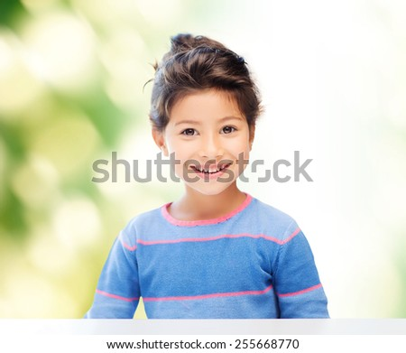 childhood, people and happiness concept - little student girl over green background - stock photo