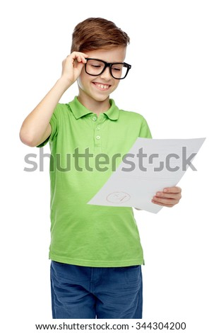 childhood, school, education and people concept - happy smiling boy in eyeglasses holding paper with test result - stock photo