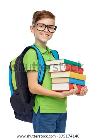 childhood, school, education and people concept - happy smiling student boy in eyeglasses with school bag and books - stock photo