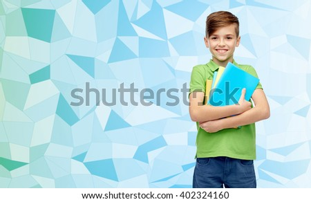 childhood, school, education and people concept - happy smiling student boy with folders and notebooks over blue low poly texture background - stock photo