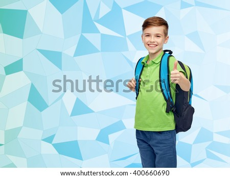 childhood, school, education and people concept - happy smiling student boy with school bag over blue low poly texture background - stock photo