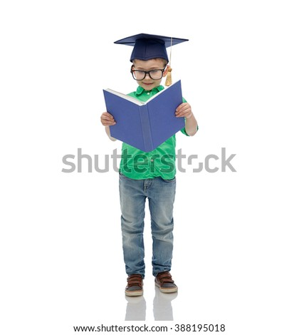 childhood, school, education, knowledge and people concept - happy boy in bachelor hat or mortarboard and eyeglasses - stock photo