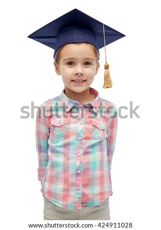 childhood, school, education, learning and people concept - happy girl with in bachelor hat or mortarboard - stock photo