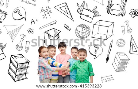 childhood, school, education, learning and people concept - happy little children with hands on top with doodles - stock photo