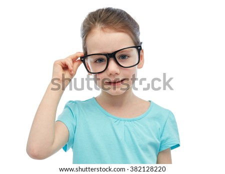 childhood, school, education, vision and people concept - happy little girl in eyeglasses