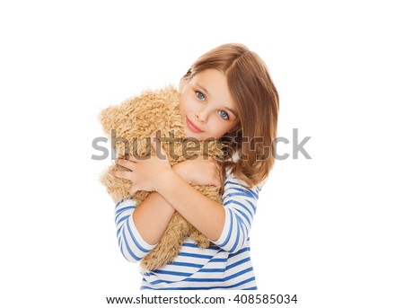 childhood, toys and people concept - cute little girl hugging teddy bear