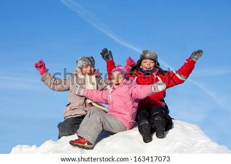 Children against the sky in winter. Happy kids on snow