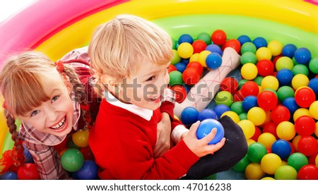 Children and ball group on playground in park.Outdoor. - stock photo