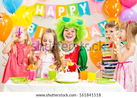 children and clown at birthday party - stock photo