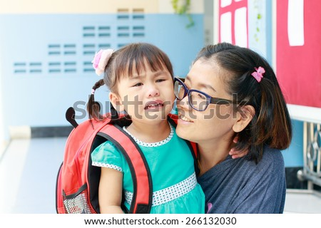 children and mother crying first day go to pre-kindergarten school  - stock photo