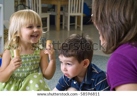 Children and teacher play with different shapes at the preschool class. - stock photo