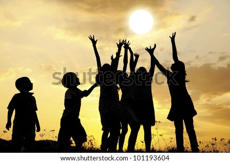 Children and the sun at sunset - stock photo