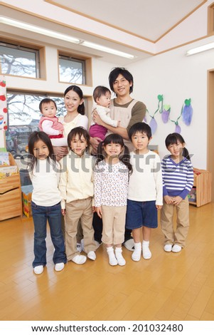 Children and two smiling nursery