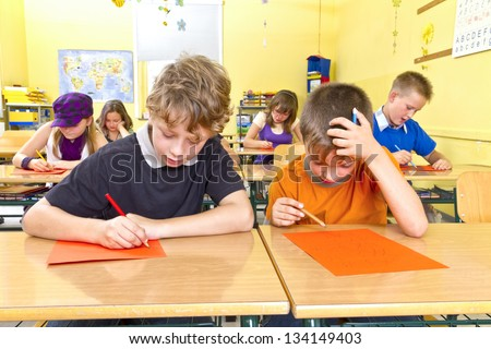 Children are doing a test in a yellow classroom at school.