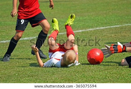 Children are playing soccer - stock photo