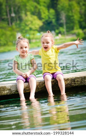 Children are smiling and having fun at the lake - stock photo