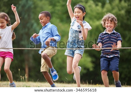 Children arriving to the finish line at a birthday party - stock photo