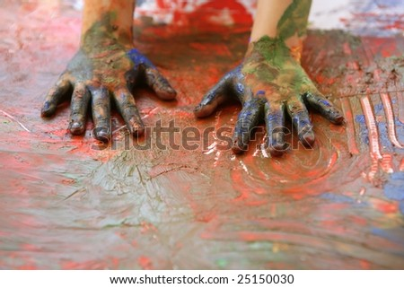Children artist hands painting colorful with her fingers - stock photo