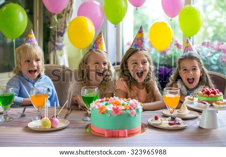 Children at a birthday party at home - stock photo
