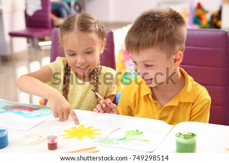 children at painting lesson in classroom - Children Painting Images