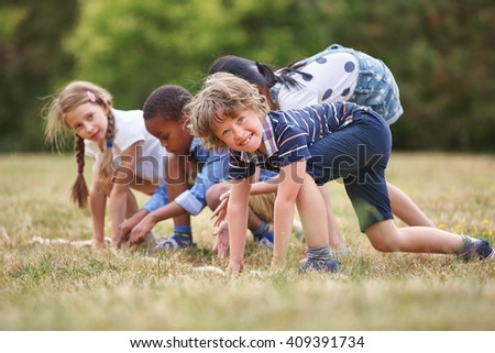 Children at the start of a race ready to go - stock photo