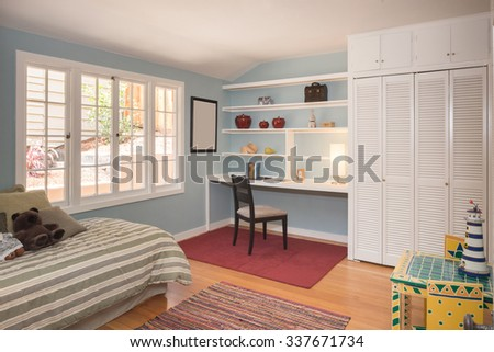 Children bedroom / kids room with light colorful decoration, rug, bed and desk. - stock photo